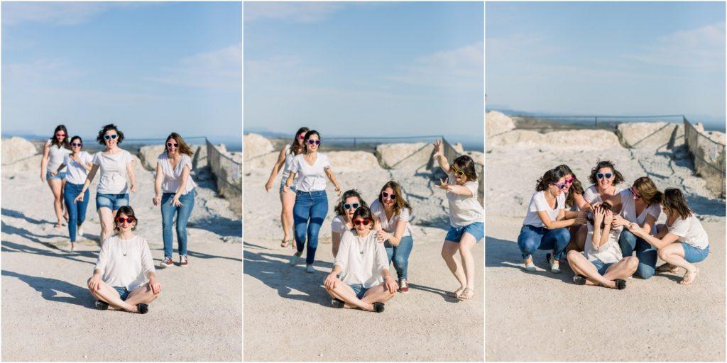 Seance photo EVJF aux baux de Provence où la future mariée attend et ses amies court derrière elle